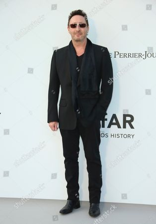 Julian Lennon poses for photographers upon arrival at the amfAR, Cinema Against AIDS, benefit at the Hotel du Cap-Eden-Roc, during the 72nd international Cannes film festival, in Cap d'Antibes, southern France