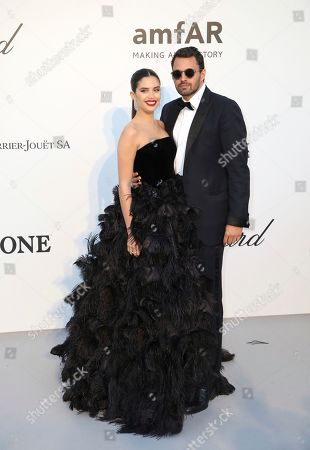 Sara Sampaio, Oliver Ripley. Model Sara Sampaio, left, and Oliver Ripley pose for photographers upon arrival at the amfAR, Cinema Against AIDS, benefit at the Hotel du Cap-Eden-Roc, during the 72nd international Cannes film festival, in Cap d'Antibes, southern France
