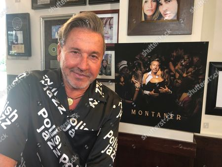 "Ricardo Montaner poses at his restaurant in Surfside, Fla., during an interview on . The Venezuelan-Argentine singer is releasing his 25th album, ""Montaner,"" on Friday"