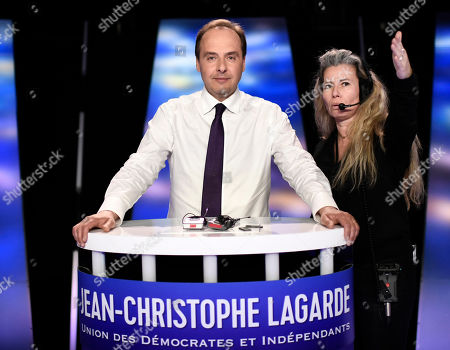 Front-runner candidate for France's UDI political party Jean-Christophe Lagarde (C) prepares for a TV debate as part of the campaign for the European elections, on the set of the French TV channel BFM, in La Plaine-Saint-Denis, outside Paris, France, 23 May 2019. The European Parliament elections are held the member countries of the European Union from 23 to 26 May 2019.