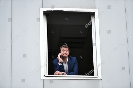 Front-runner candidate for French Ecologist Party EELV Yannick Jadot uses a mobile phone before a TV debate as part of the campaign for the European elections, on the set of the French TV channel BFM, in La Plaine-Saint-Denis, outside Paris, France, 23 May 2019. The European Parliament elections are held the member countries of the European Union from 23 to 26 May 2019.