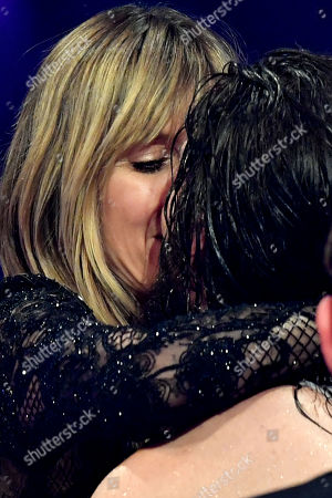 German supermodel and presenter Heidi Klum (L) kisses her boyfriend German musician Tom Kaulitz (R) of pop-rock band 'Tokio Hotel' during the final of TV program 'Germany's Next Topmodel' by Heidi Klum in Duesseldorf, Germany, 23 May 2019. It is the 14th edition of the annual model casting reality television series hosted by German model Heidi Klum.