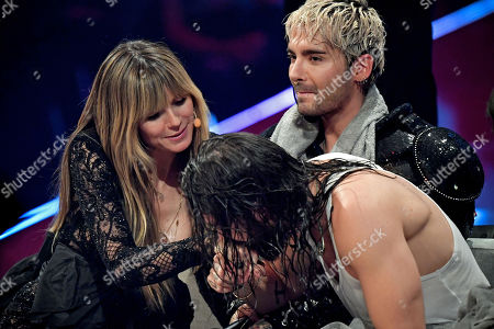 Tom Kaulitz (R) of pop-rock band 'Tokio Hotel' kisses his girlfriend, German supermodel and presenter Heidi Klum (L), across his brother Bill Kaulitz (C) during the final of TV program 'Germany's Next Topmodel' by Heidi Klum in Duesseldorf, Germany, 23 May 2019. It is the 14th edition of the annual model casting reality television series hosted by German model Heidi Klum.