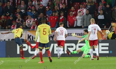 Colombia's Luis Sandoval, left, scores his side's second goal during the Group A U20 World Cup soccer match between Poland and Colombia in Lodz, Poland