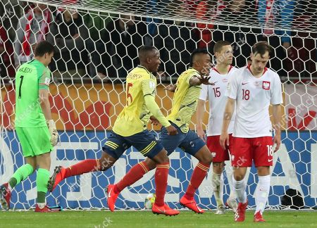 Colombia's Luis Sandoval, centre, celebrates after scoring his side's second goal during the Group A U20 World Cup soccer match between Poland and Colombia in Lodz, Poland