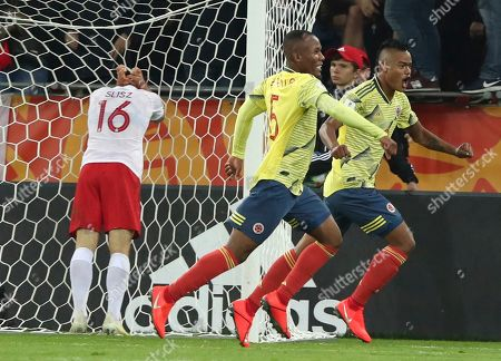 Colombia's Luis Sandoval, right, celebrates after scoring his side's second goal during the Group A U20 World Cup soccer match between Poland and Colombia in Lodz, Poland