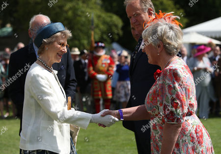The Duchess of Gloucester (left) greeting Rosie Thompson, Head of Events at the Not Forgotten Association Annual Garden Party at Buckingham Palace