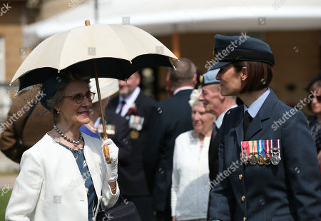 The Duchess of Gloucester (left) meeting veterans at the Not Forgotten Association Annual Garden Party at Buckingham Palace