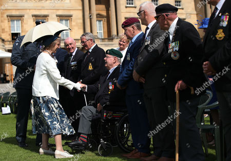 Stock Image of The Duchess of Gloucester meeting veteran Terry Durkin, who served with the Royal Marines 45 Commando, during the Not Forgotten Association Annual Garden Party at Buckingham Palace