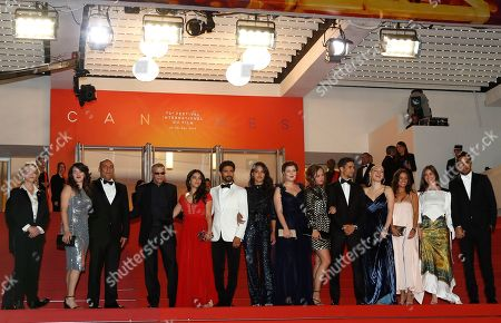 Abdellatif Kechiche (4-L) arrives with cast and crew for the screening of 'Mektoub, My Love: Intermezzo' during the 72nd annual Cannes Film Festival, in Cannes, France, 23 May 2019. The movie is presented in the Official Competition of the festival which runs from 14 to 25 May.