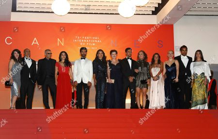 Abdellatif Kechiche (3-L) arrives with cast and crew for the screening of 'Mektoub, My Love: Intermezzo' during the 72nd annual Cannes Film Festival, in Cannes, France, 23 May 2019. The movie is presented in the Official Competition of the festival which runs from 14 to 25 May.