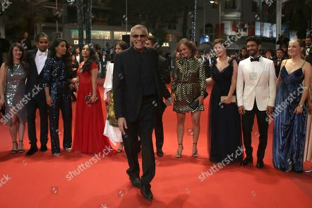 Director Abdellatif Kechiche, front center, with cast and crew pose for photographers upon arrival at the premiere of the film 'Mektoub, My Love: Intermezzo' at the 72nd international film festival, Cannes, southern France