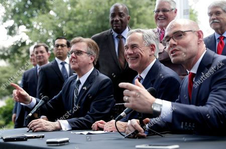 Greg Abbott, Dan Patrick, Dennis Bonnen. Governor Greg Abbott, seated center, Lt. Governor Dan Patrick, seated left, and Speaker of the House Dennis Bonnen, seated right, and other law makers attend a joint press conference to discuss teacher pay and school finance at the Texas Governor's Mansion in Austin, Texas, in Austin