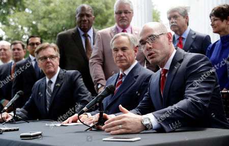 Greg Abbott, Dan Patrick, Dennis Bonnen. Lt. Governor Dan Patrick, seated left, and Governor Greg Abbott, seated center, listen as Speaker of the House Dennis Bonnen, seated right, answers a question during a joint news conference to discuss teacher pay and school finance at the Texas Governor's Mansion in Austin, Texas, in Austin