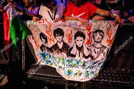 Fans displaying artwork in support of One Ok Rock