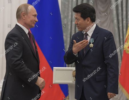 Russian President Vladimir Putin (left) and Chinese Ambassador to Russia Li Hui (right) at the ceremony.