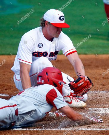 Jacob Nesbit, Cole Wilcox. Arkansas' Jacob Nesbit beats the tag from Georgia pitcher Cole Wilcox as he slides into home during the third inning of a Southeastern Conference tournament NCAA college baseball game, in Hoover, Ala
