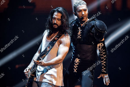 Stock Image of Tom Kaulitz (L) and Bill Kaulitz (R) of pop-rock band 'Tokio Hotel' perform during the final of the television program 'Germany's Next Topmodel' in Duesseldorf, Germany, 23 May 2019. It is the 14th edition of the annual model casting reality television series hosted by German model Heidi Klum.