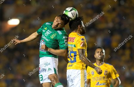 Tigres UANL's Javier Aquino (R) vies for the ball with Angel Mena (L) of Leon during the first leg of the Clausura 2019 final between the Tigres and Leon held at the University Stadium in Monterrey, Mexico, 23 May 2019.