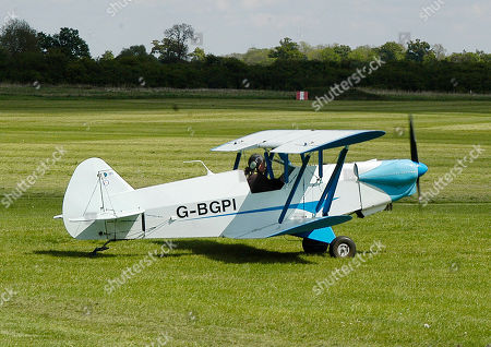 Stock Image of Plumb BGP-1 owned and flown by Barry George Plumb who is sitting in the cockpit