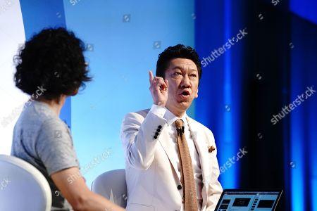 Stock Photo of Akihito Kunimi (Executive Creative Director, Dentsu Inc.), left, and Tomoyasu Hotei (Musician & Record Producer)