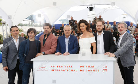 Marco Bellocchio (C), Italian actor Pierfrancesco Favino (3-L), Brazilian actress Maria Fernanda Candido (3-R), Italian actor Fausto Russo Alesi (2-R), Italian actor Fabrizio Ferracane (R), Italian actor Luigi Lo Cascio (2-L) and a guest pose during the photocall for 'Il Traditore (The Traitor)' at the 72nd annual Cannes Film Festival, in Cannes, France, 24 May 2019. The movie is presented in the Official Competition of the festival which runs from 14 to 25 May.