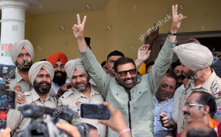 Stock Photo of Bharatiya Janata Party (BJP) candidate Sunny Deol shows victory sign after the outcome of Lok Sabha elections, at his residence,   on May 23, 2019 in Gurdaspur, India.  Sunny Deol is contesting from Gurdaspur seat which was earlier represented by late Bollywood actor Vinod Khanna.