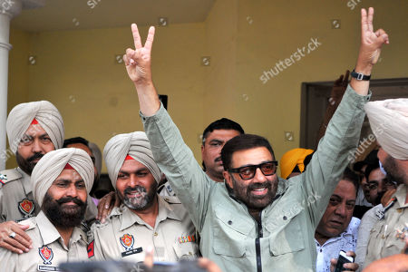 Stock Image of Bharatiya Janata Party (BJP) candidate Sunny Deol shows victory sign after the outcome of Lok Sabha elections, at his residence,   on May 23, 2019 in Gurdaspur, India.  Sunny Deol is contesting from Gurdaspur seat which was earlier represented by late Bollywood actor Vinod Khanna.