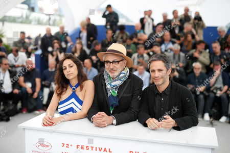 Yasmine Hamdan (L), Palestine director Elia Suleiman (C) and Mexican actor Gael Garcia Bernal pose during the photocall for 'It Must Be Heaven' at the 72nd annual Cannes Film Festival, in Cannes, France, 24 May 2019. The movie is presented in the Official Competition of the festival which runs from 14 to 25 May.