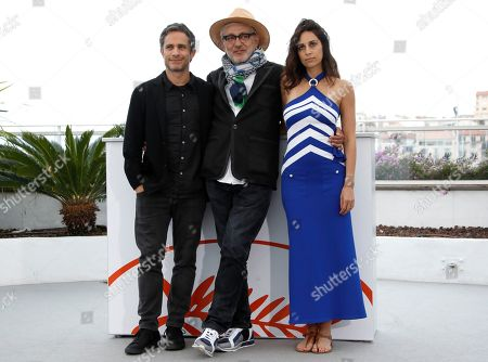 Yasmine Hamdan (R), Palestine director Elia Suleiman (C) and Mexican actor Gael Garcia Bernal pose during the photocall for 'It Must Be Heaven' at the 72nd annual Cannes Film Festival, in Cannes, France, 24 May 2019. The movie is presented in the Official Competition of the festival which runs from 14 to 25 May.