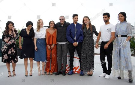 French actress Athenais Sifaoui (L), French actress Lou Luttiau (3-R), French actress Marie Bernard (3-L), Meleinda Elasfour (4-L), Tunisian director Abdellatif Kechiche (C), French actor Shain Boumedine (4-R), French actor Salim Kechiouche (2-R), French actress Hafsia Herzi (2-L) and Dany Martial (R) pose during the photocall for 'Mektoub, My Love: Intermezzo' at the 72nd annual Cannes Film Festival, in Cannes, France, 24 May 2019. The movie is presented in the Official Competition of the festival which runs from 14 to 25 May.