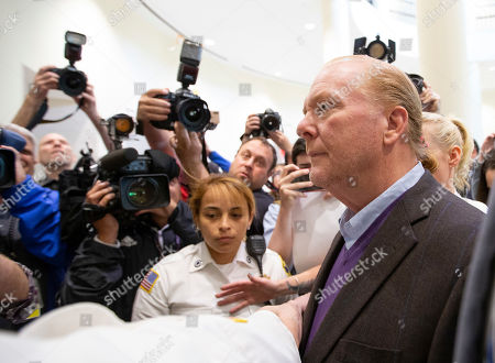 Celebrity chef Mario Batali (R) exits the Boston Municipal Court where he faces a criminal charge of indecent assault and battery in Boston, Massachusetts, USA, 24 May 2019. The charges stem from an alleged incident in March of 2017 where he is accused of groping a woman who was taking a selfie with him.