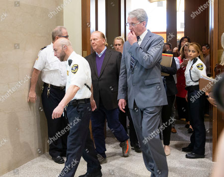 Celebrity chef Mario Batali (3L) exits the court room in Boston Municipal Court where he faces a criminal charge of indecent assault and battery in Boston, Massachusetts, USA, 24 May 2019. The charges stem from an alleged incident in March of 2017 where he is accused of groping a woman who was taking a selfie with him.