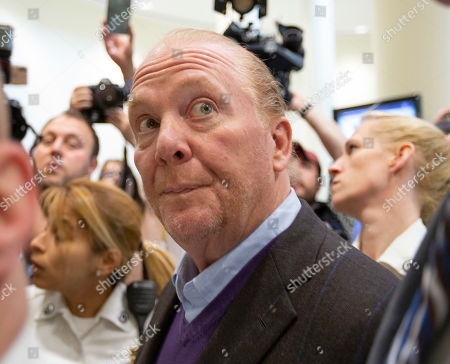 Celebrity chef Mario Batali (C) exits the Boston Municipal Court where he faces a criminal charge of indecent assault and battery in Boston, Massachusetts, USA, 24 May 2019. The charges stem from an alleged incident in March of 2017 where he is accused of groping a woman who was taking a selfie with him.