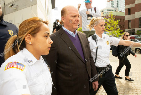 Celebrity chef Mario Batali (C) is escorted by Court Officers as he exits the Boston Municipal Court where he faces a criminal charge of indecent assault and battery in Boston, Massachusetts, USA, 24 May 2019. The charges stem from an alleged incident in March of 2017 where he is accused of groping a woman who was taking a selfie with him.