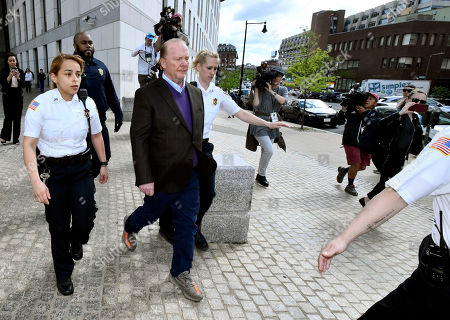 Chef Mario Batali departs after pleading not guilty, at municipal court in Boston, to an allegation that he forcibly kissed and groped a woman at a Boston restaurant in 2017