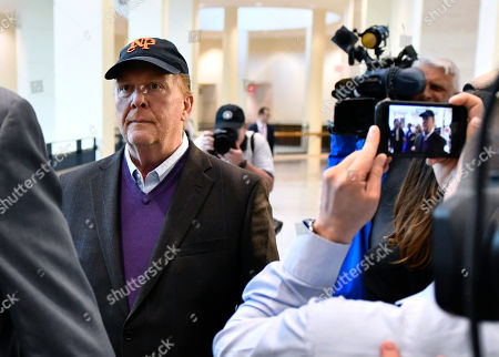 Chef Mario Batali [arrives for / stands during] arraignment, at municipal court in Boston, on charges he forcibly kissed and groped a woman at a Boston restaurant in 2017