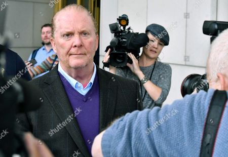 Chef Mario Batali departs after pleading not guilty, at municipal court in Boston, to charges he forcibly kissed and groped a woman at a Boston restaurant in 2017
