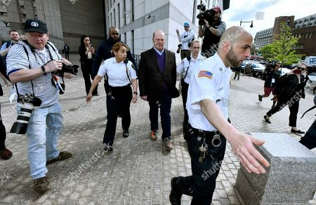 Stock Photo of Chef Mario Batali, center, departs after pleading not guilty, at municipal court in Boston, to charges he forcibly kissed and groped a woman at a Boston restaurant in 2017