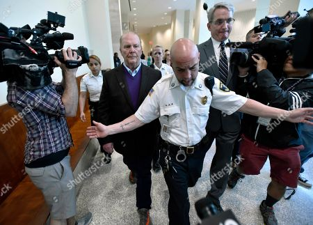 Stock Picture of Chef Mario Batali, center left, departs after pleading not guilty, at municipal court in Boston, to charges he forcibly kissed and groped a woman at a Boston restaurant in 2017