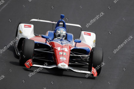 Tony Kanaan, of Brazil, drives into turn one during the final practice session for the Indianapolis 500 IndyCar auto race at Indianapolis Motor Speedway, in Indianapolis