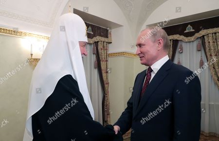 Russian President Vladimir Putin (R) meets with Patriarch Kirill of Moscow and All Russia to commemorate the day of Saints Cyril and Methodius, Christian missionaries who influenced the religious and cultural development of all Slavic people, at the Kremlin in Moscow, Russia, 24 May 2019.