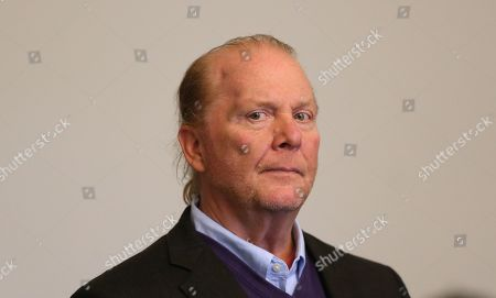 Celebrity chef Mario Batali (R) stands in the Boston Municipal Court where he faces a criminal charge of indecent assault and battery in Boston, Massachusetts, USA, 24 May 2019. The charges stem from an alleged incident in March of 2017 where he is accused of groping a woman who was taking a selfie with him.