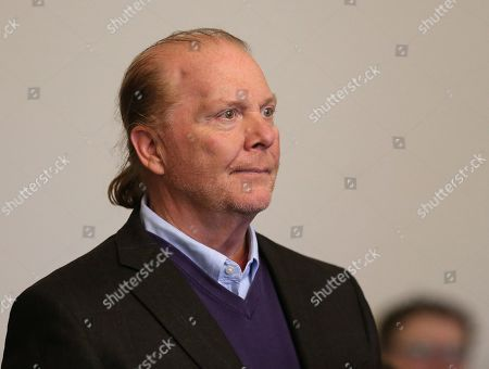 Celebrity chef Mario Batali stands in the Boston Municipal Court where he faces a criminal charge of indecent assault and battery in Boston, Massachusetts, USA, 24 May 2019. The charges stem from an alleged incident in March of 2017 where he is accused of groping a woman who was taking a selfie with him.