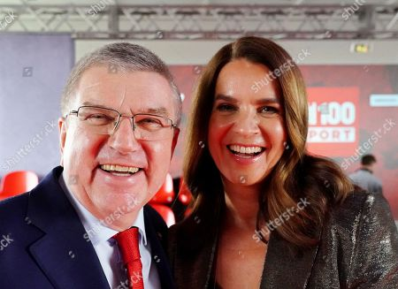 IOC president Thomas Bach (L) and former German figure skater Katarina Witt (R) attend the BILD100 Sport event in Berlin, Germany, 24 May 2019. The event invites 100 of the most important and influential German and International personalities of Politics, Economics, and Sport.