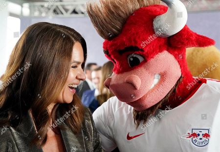 Stock Photo of Former German figure skater Katarina Witt poses with the RB Leipzig mascot during the BILD100 Sport event in Berlin, Germany, 24 May 2019. The event invites 100 of the most important and influential German and International personalities of Politics, Economics, and Sport.
