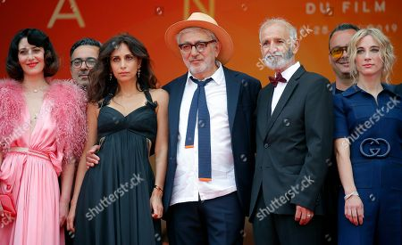 Yasmine Hamdan (2-L), Palestine director Elia Suleiman (C), Canadian producer Nancy Grant (R), Israeli actor Tarik Kopty (2-R) and Canadian actress Raia Haidar (L) arrive for the screening of 'It Must Be Heaven' at the 72nd annual Cannes Film Festival, in Cannes, France, 24 May 2019. The movie is presented in the Official Competition of the festival which runs from 14 to 25 May.