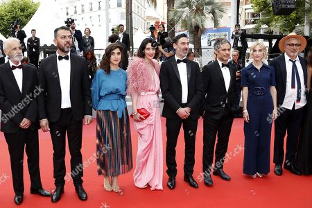 Stock Photo of Israeli actor Tarik Kopty, Israeli actor Karim Ghneim, French actress Yasmine Haj, Lebanese actress Raia Haidar, Canadian actor Fadi Sakr, Mexican actor Gael Garcia Bernal, Canadian producer Nancy Grant and Palestine director Elia Suleiman arrive for the screening of 'It Must Be Heaven' at the 72nd annual Cannes Film Festival, in Cannes, France, 24 May 2019. The movie is presented in the Official Competition of the festival which runs from 14 to 25 May.