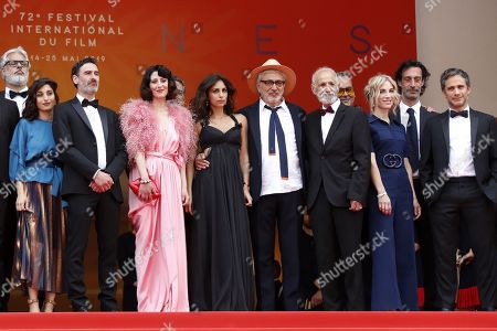 French actress Yasmine Haj, Canadian actor Fadi Sakr, Lebanese actress Raia Haidar, Lebanese actress Yasmine Hamdan, Palestine director Elia Suleiman, Israeli actor Tarik Kopty, Canadian producer Nancy Grant and Mexican actor Gael Garcia Bernal arrive for the screening of 'It Must Be Heaven' at the 72nd annual Cannes Film Festival, in Cannes, France, 24 May 2019. The movie is presented in the Official Competition of the festival which runs from 14 to 25 May.