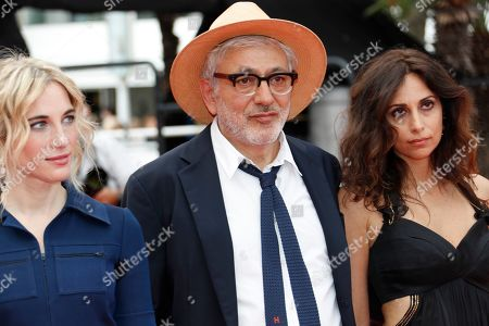 Nancy Grant, Palestine director Elia Suleiman and Lebanese actress Yasmine Hamdan arrive for the screening of 'It Must Be Heaven' at the 72nd annual Cannes Film Festival, in Cannes, France, 24 May 2019. The movie is presented in the Official Competition of the festival which runs from 14 to 25 May.